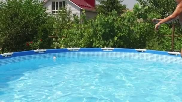 Swimming pool. Little girl jumping into the water in a pool. Slow motion. HD