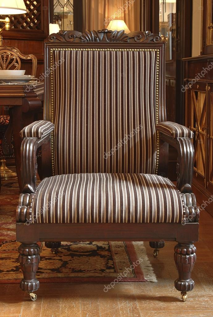 Upholstered With A Striped Fabric Armchair With Armrests And Carved Legs U2014  Stock Photo