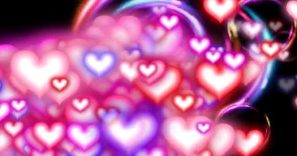Valentin-nap szívét és Circles nagy R L. Fade loop-gyönyörű többszínű gyűrűk animálni a képernyőn, míg a különböző színek a szeretet szívét úszó.