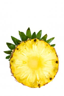 round slice of ripe tasty pineapple with leaf isolated on white
