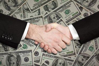 businessman handshake isolated on hundred dollar money