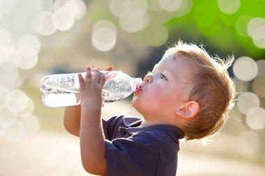 Beautiful blonde child drink water outdoor stock vector