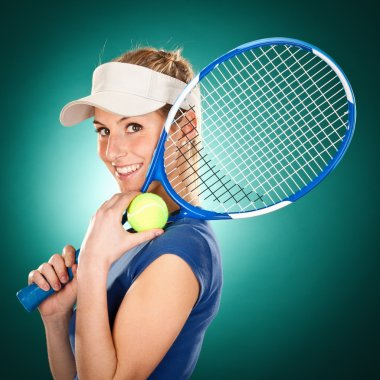 Young blonde beautiful tennis player portrait on green background