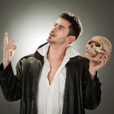 modern hamlet with skull portrait on black background