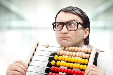 funny nerd man with an abacus at office