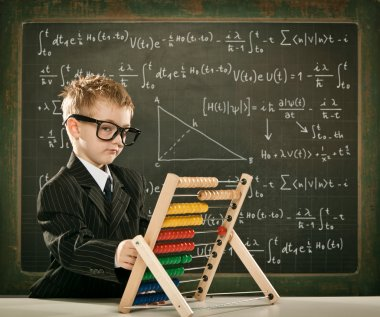 young clever scientist children students with abacus and blackboard
