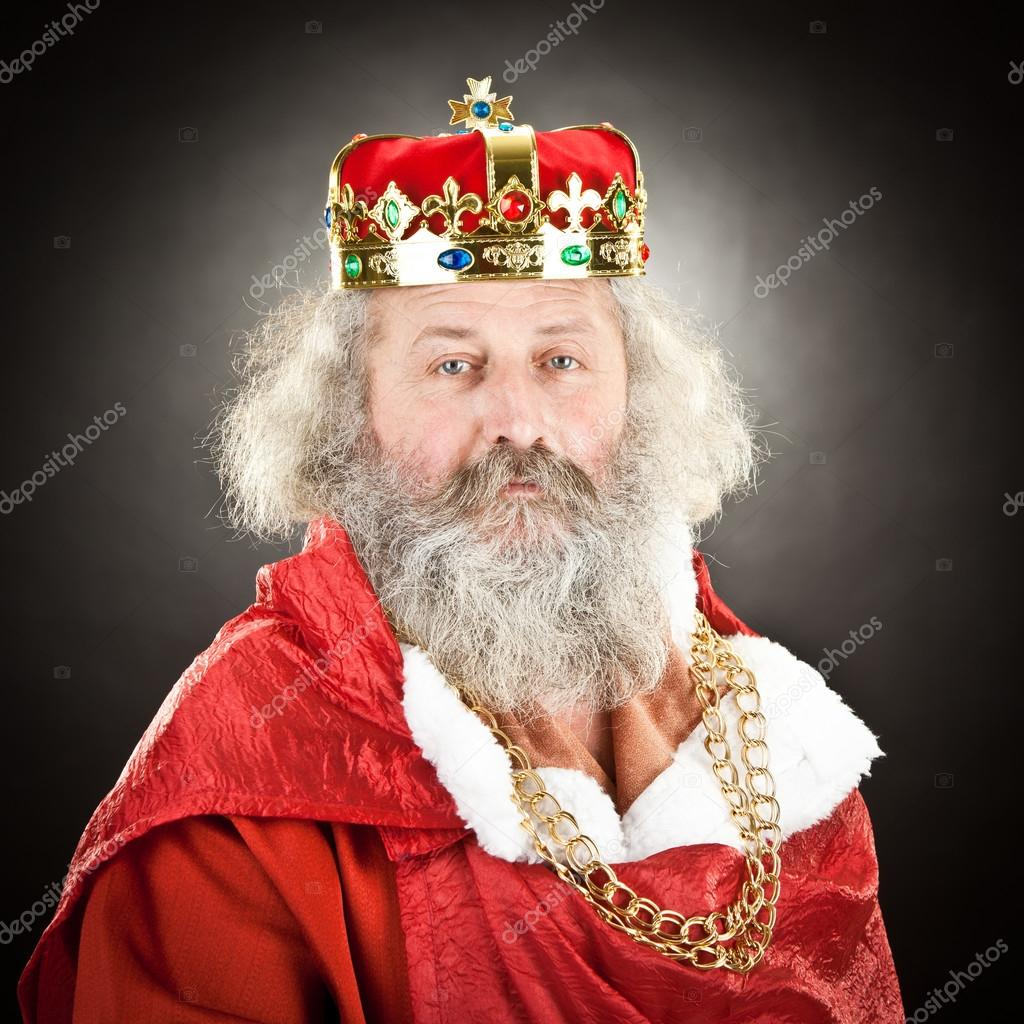 old king with crown and jewels isolated on black