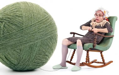 funny old lady knit with huge ball of yarn isolated on white