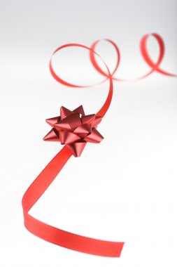 red gift wrap ribbon with bow