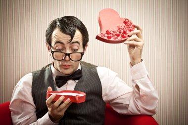 Surprised nerd man open chocolate box love gift