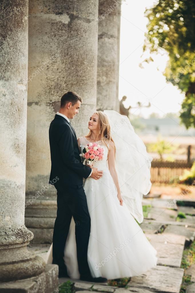 Beautiful Romantic Wedding Couple Of Newlyweds Hugging Near Old Castle Stock Photo C Olegparylyak Gmail Com 102570960