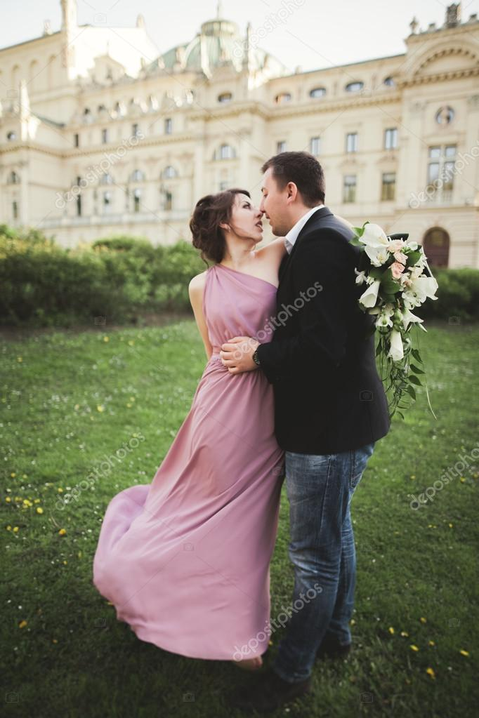 Wedding. Couple. Krakow. The bride in a pink dress and groom