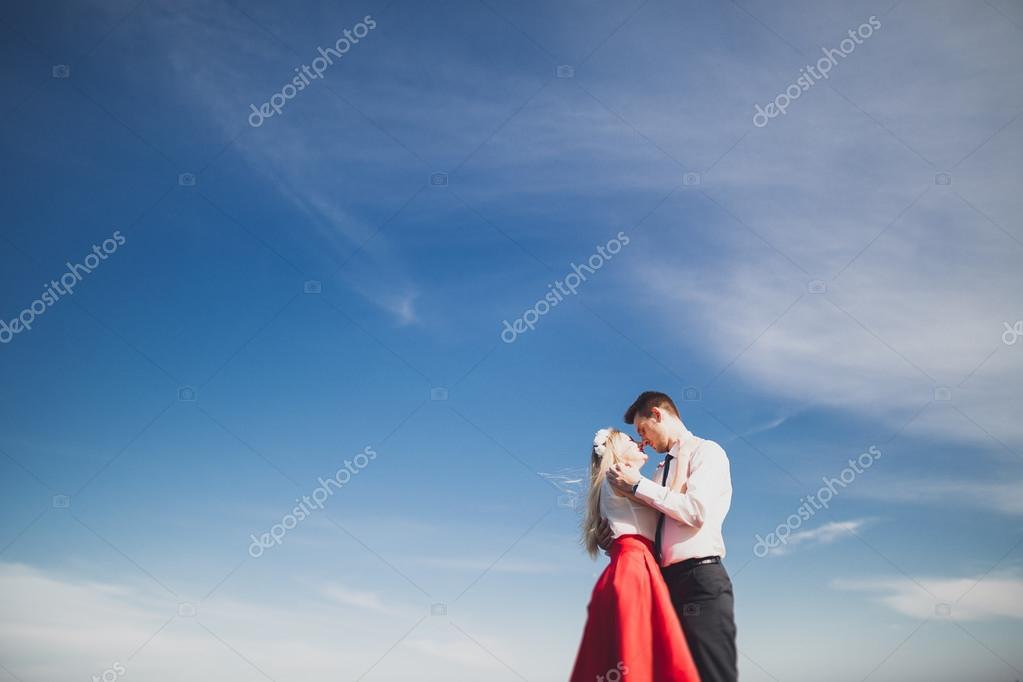 Romantic Loving Couple Posing On Stones Near Sea Blue Sky Stock