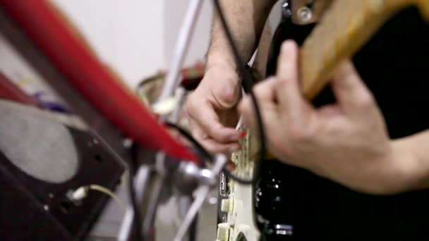 musician, no one finger on the hand playing the electric guitar