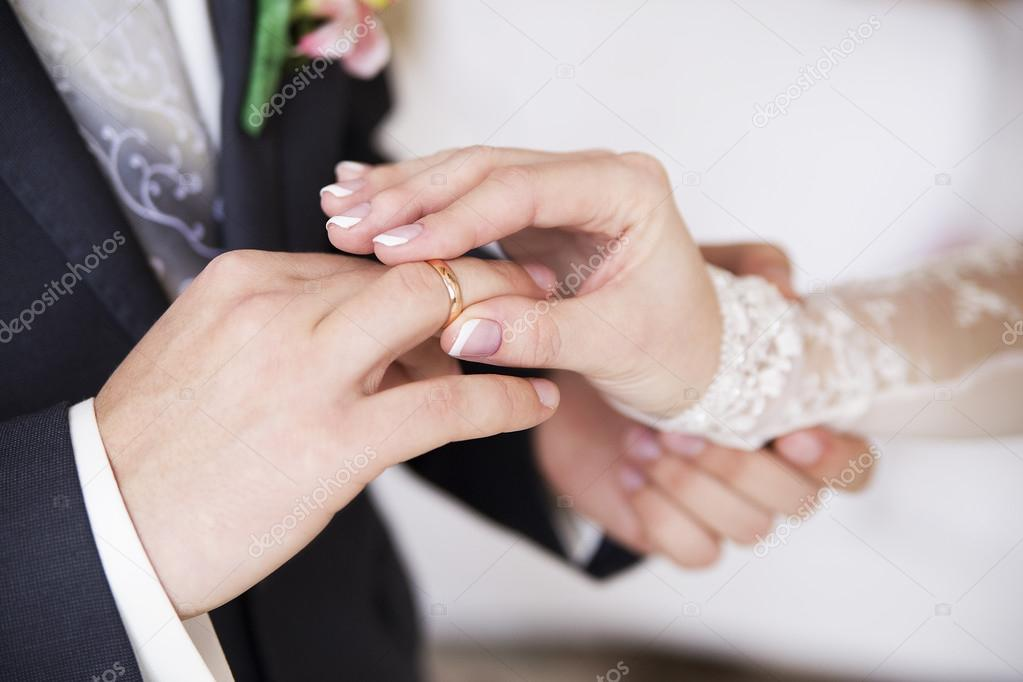 Groom wears bride a ring on the finger fotografias de stock groom wears bride a ring on the finger fotografia de stock junglespirit Image collections