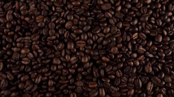 a fresh roasted coffee beans falling on the table