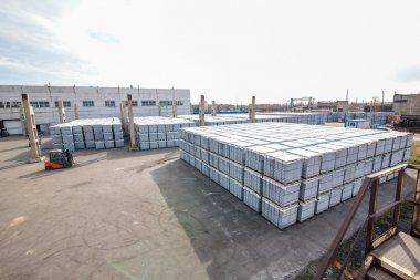 Stack of concrete blocks near house-building factory