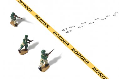 Toy Army Men Protecting Border Crossing from Unknown Footprints