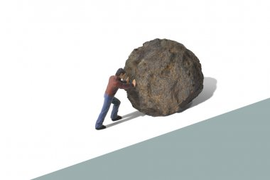 Toy Person Pushing a Large Boulder Uphill