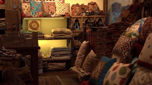 Colorful traditional Turkish pillows and souvenirs in store