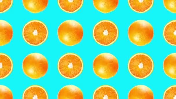 Wonderful pattern made of juicy orange fruits on turquoise
