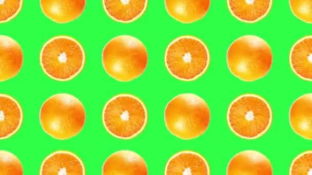 Fantastic pattern of cut and whole oranges turning on green