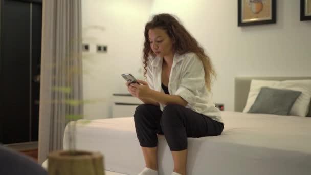 Stylish mixed race lady types message on smartphone chatting