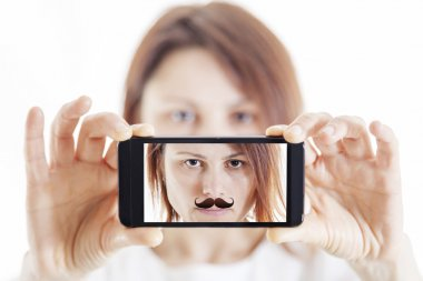 pretty woman with moustache taking a selfie using her smartphone