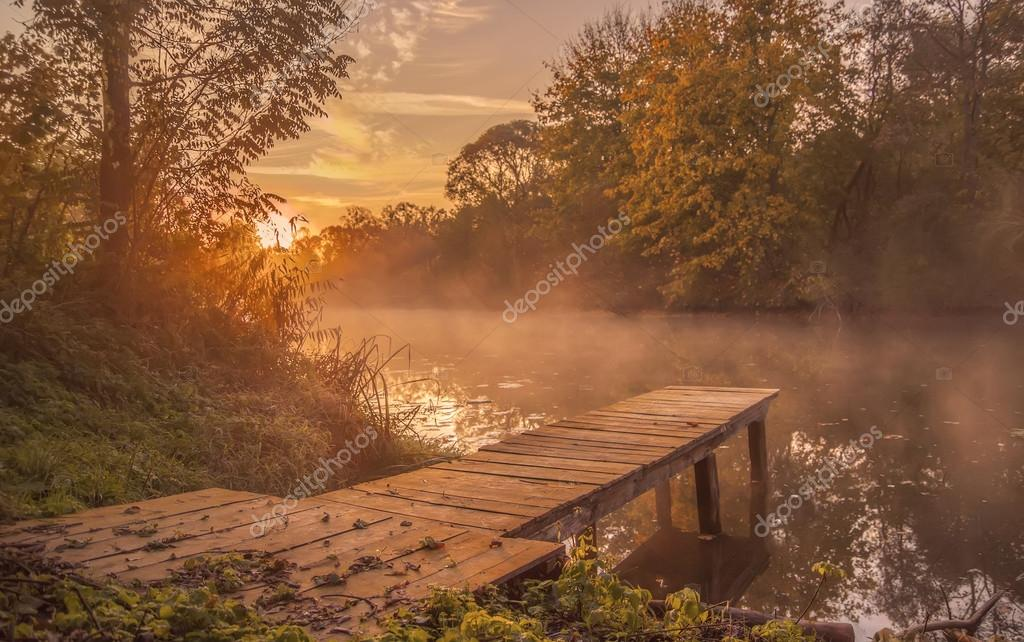 Landscape.bridge frost wooden on the shore of river in the morni