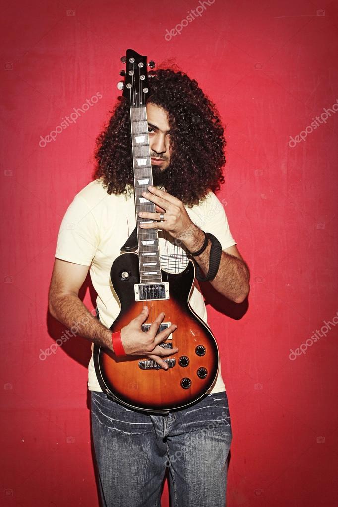 Young Guy Holding An Electric Guitar Beautiful Long Curly Hair Stock Photo C Aleemzahidkhan Yahoo Com 119992524