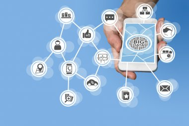 Big data concept in order to analyze large volume of data from connected mobile devices. Hand holding smart phone on white background