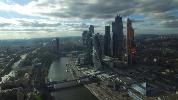 Moscow city business center. Fast helicopter approach. High altitude. Dramatic movie style epic shot. Modern Russian skyscrapers aerial drone flight.