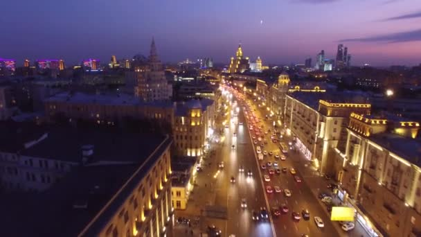 Sadovoe ring evening road traffic. Center of Moscow night illumination. Aerial drone from above view to moving cars.