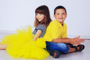 friends, little boy and girl in a luxurious dress, sitting room