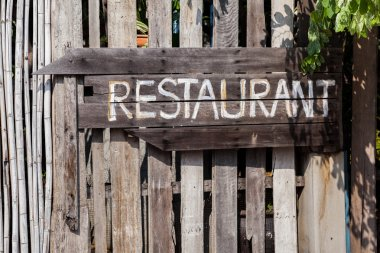 Wooden handmade sign restaurant on vintage plate
