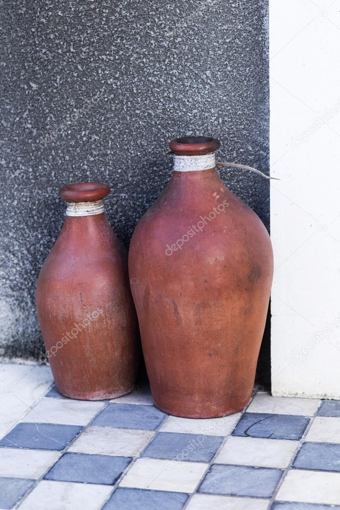 Two vintage red vases mexican style