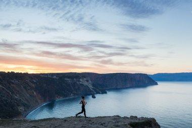 Woman running near sea