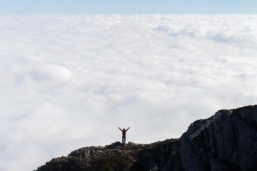 Man standing in the mountains