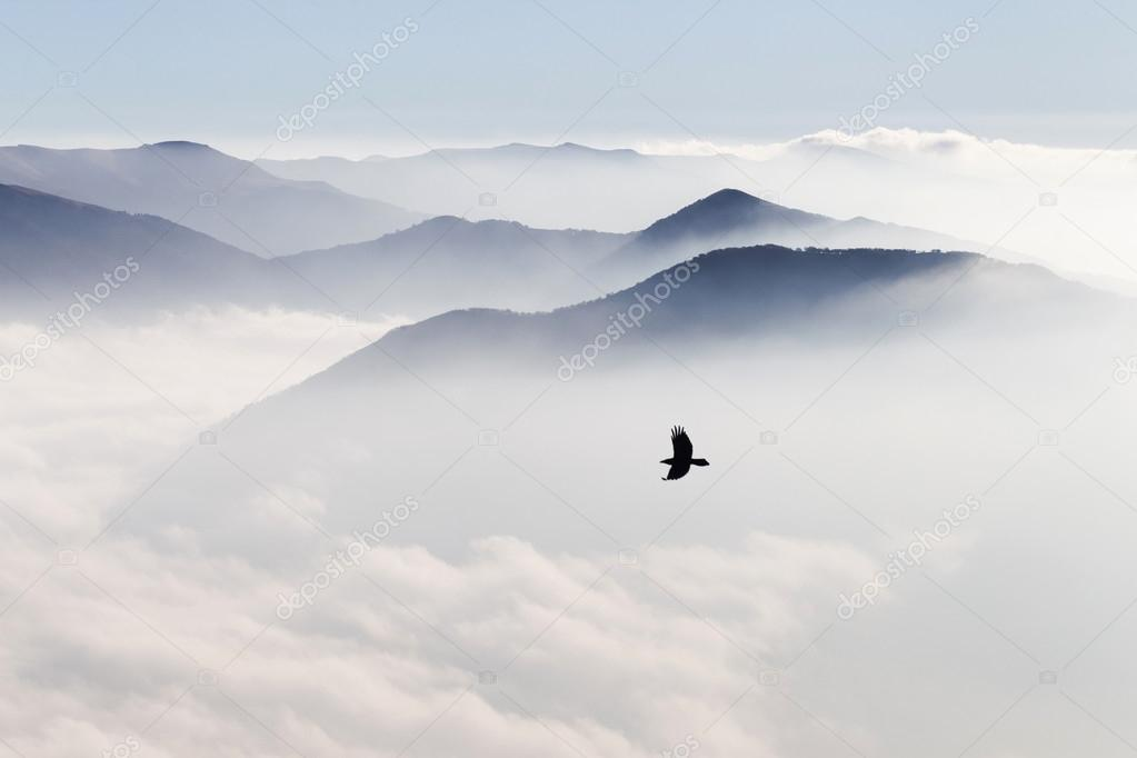 Silhouettes of mountains in the mist