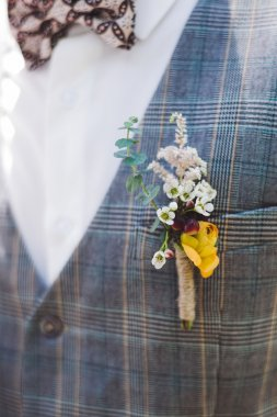 Bright groom boutonniere