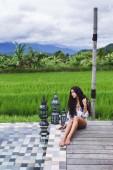 Girl near luxury pool in Bali