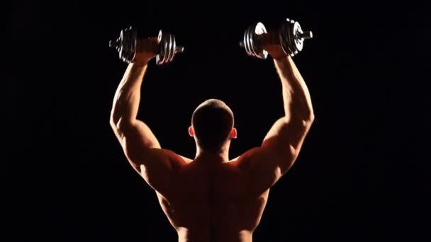 bodybuilder with dumbbells gym