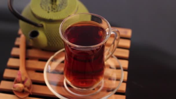 Turkish black tea with traditional and colorful serve