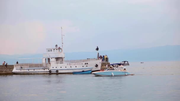 OHRID, MACEDONIA, JUNE 2015: Ships traveling at the Ohrid lake. Ohrid is famous for its unesco listed historical center and beautiful lake separating Macedonia from Albania.