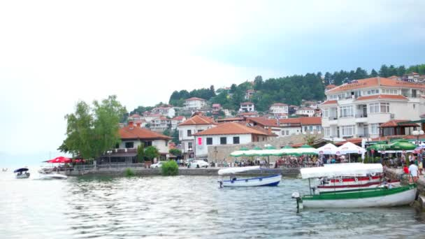 OHRID, MACEDONIA, JUNE 2015: Beautiful seaside view of Ohrid town from the Ohrid lake. Ohrid is famous for its unesco listed historical center and beautiful lake separating Macedonia from Albania.