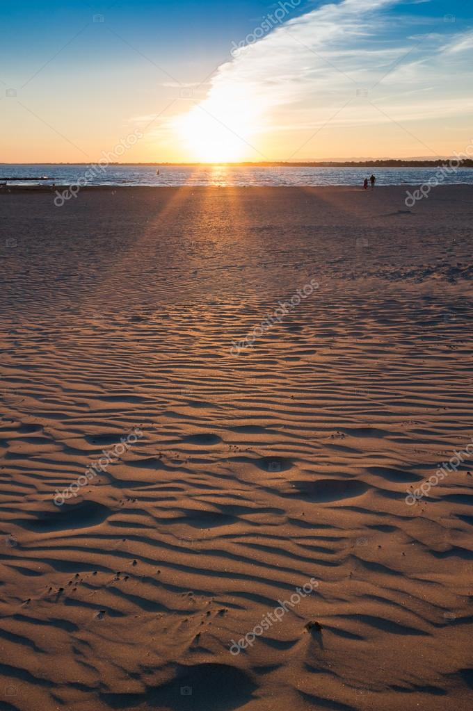 Sunset and the beach of mediterranean sea
