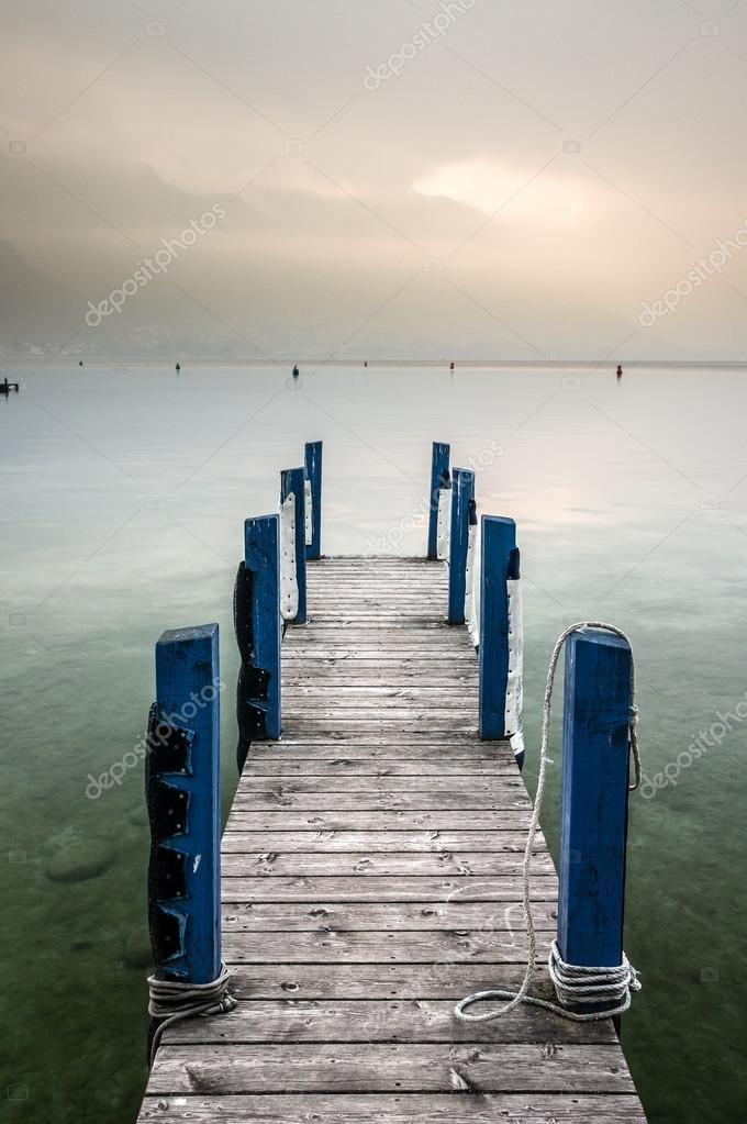 Wooden dock and blue pillar