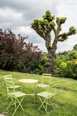 Chairs and table on a lawn