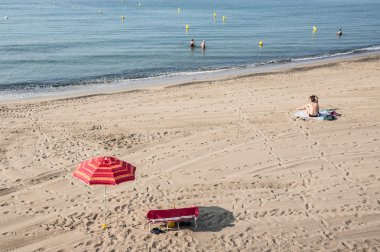 Red Striped Parasol  on the beach