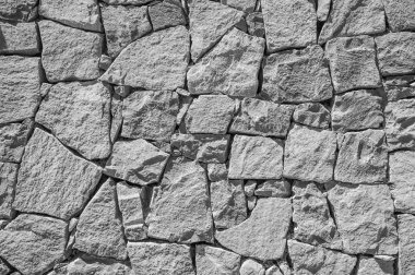 Black and white rough stone wall texture stock vector